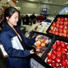 A delegate admires the produce on display.